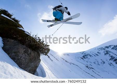 good skiing in the snowy mountains, Carpathians, Ukraine, wonderful winter day, incredible ski jump, ski season #760249132