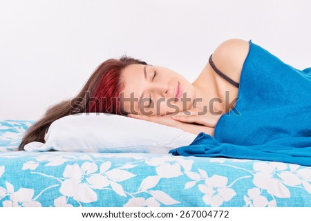 Good sleep is very important. Young girl sleeping in her bed