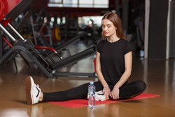 Good stretching in the gym.Young woman workout in gym healthy lifestyle