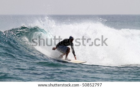 good surfer in action on a nice tropical wave