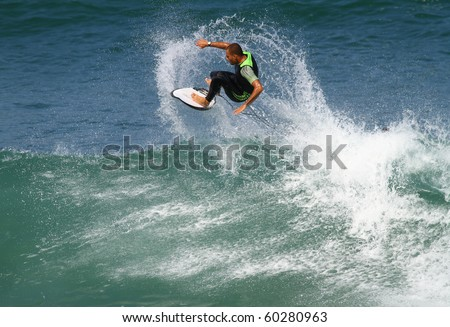 good surfer in action on a powerful wave #60280963