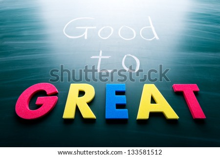 Good to great, conceptual words on blackboard - stock photo