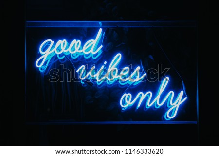 Good vibes only words in neon light signage.