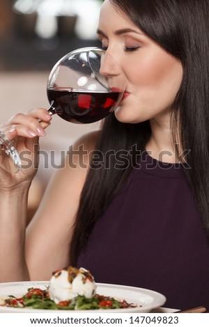 Good wine. Portrait of beautiful mature women drinking wine in restaurant