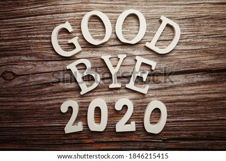 Goodbye 2020 alphabet letter on wooden background