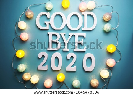 Goodbye 2020 alphabet letter with cotton ball LED decoration on blue background