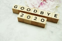 Goodbye 2020 alphabet letters on marble background