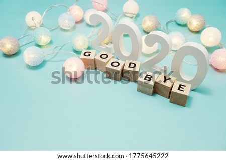 Goodbye 2020 alphabet letters with space copy on blue background