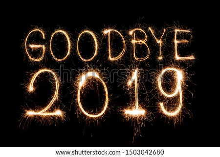 Goodbye 2019,Creative text Happy New Year written sparkling sparklers isolated on black background for design