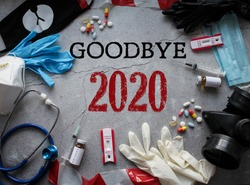 Goodbye 2020! Symbols of the outgoing year: respirators and masks, pills and vaccine, coronavirus tests and tape fencing. The concept of survival and pandemics