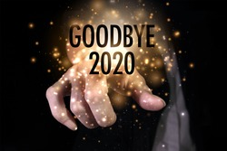 Goodbye 2020 with hand. New year is the first day of the year in the Gregorian calendar.