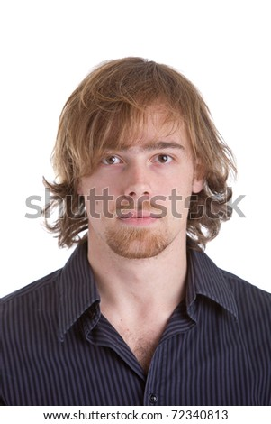 Goodlooking young caucasian man with half long hair on white background