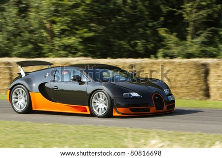 GOODWOOD, UK - JULY 3: black bugatti veyron supersport on the hill at the annual  Goodwood Festival of Speed on July, 3 2011 in Goodwood England - stock photo