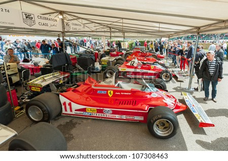 GOODWOOD, UK - JULY 1: Collection of classic Ferrari F1 racing cars in the service pits at the Festival of Speed motor-sport event held at Goodwood, UK on July 1, 2012
