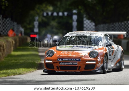 GOODWOOD, UK - JULY 1: The Porsche 911 GT3 Cup Car drives up the hill at the Festival of Speed hill course at Goodwood, UK on July 1, 2012