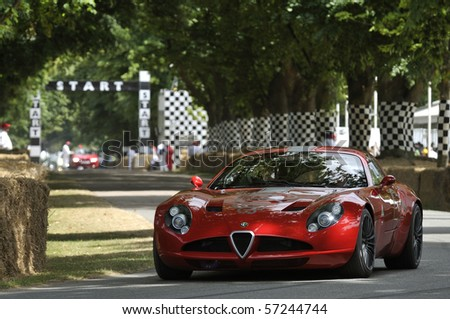 GOODWOOD, UNITED KINGDOM - JULY 3:Alfa Romeo TZ3 Zagato drives up the hill at the Goodwood Festival of Speed in the United Kingdom on July 3, 2010 in Goodwood, UK