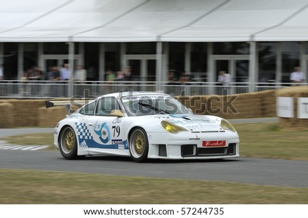 GOODWOOD, UNITED KINGDOM - JULY 3: Classic Porsche Racing Car drives up the hill at the Goodwood Festival of Speed in the United Kingdom on July 3, 2010 in Goodwood, UK