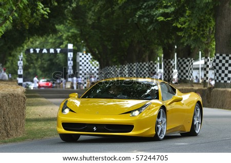 GOODWOOD, UNITED KINGDOM - JULY 3: Ferrari 458 drives up the hill at the Goodwood Festival of Speed in the United Kingdom on July 3, 2010 in Goodwood, UK