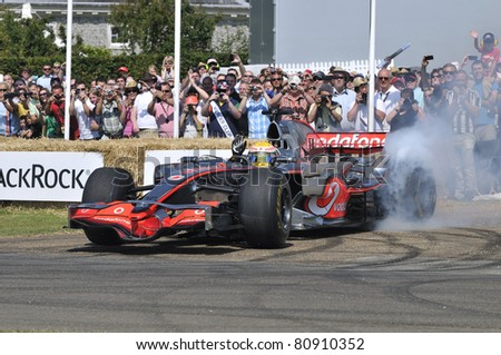 GOODWOOD, UNITED KINGDOM - JULY 1: Formula One drive Lewis Hamilton drives up the hill at the Goodwood Festival of Speed in the United Kingdom on July 1, 2011 in Goodwood, UK