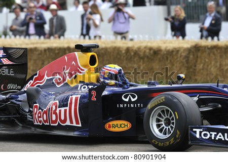 GOODWOOD, UNITED KINGDOM - JULY 1: Formula One drive Mark Webber from Red Bull Racing drives up the hill at the Goodwood Festival of Speed in the United Kingdom on July 1, 2011 in Goodwood, UK