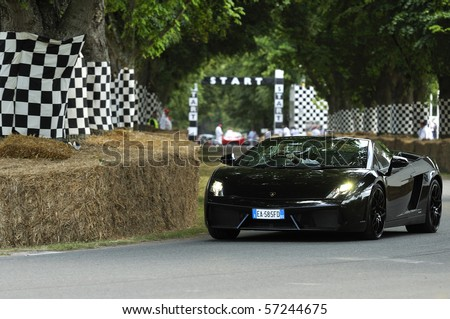 GOODWOOD, UNITED KINGDOM - JULY 3: Lamborghini Gallardo Spyder drives up the hill at the Goodwood Festival of Speed in the United Kingdom on July 3, 2010 in Goodwood, UK