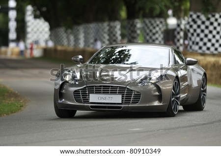 GOODWOOD, UNITED KINGDOM - JULY 1: The new and exclusive Aston Martin One-77 drives up the hill at the Goodwood Festival of Speed in the United Kingdom on July 1, 2011 in Goodwood, UK