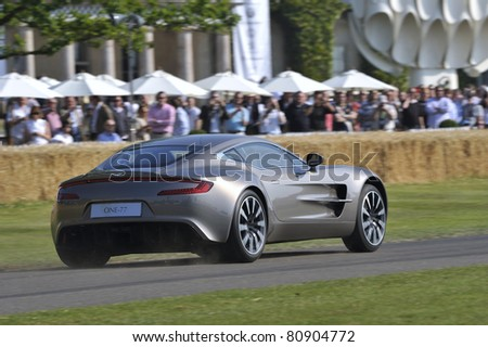 GOODWOOD, UNITED KINGDOM - JULY 3: The stunning Aston Martin One-77 drives up the hill at the Goodwood Festival of Speed in the United Kingdom on July 3rd 2010 in Goodwood, UK