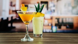 gooseberry cocktail with pilla decoration and pineapple cocktail in a glass, in a bar or restaurant