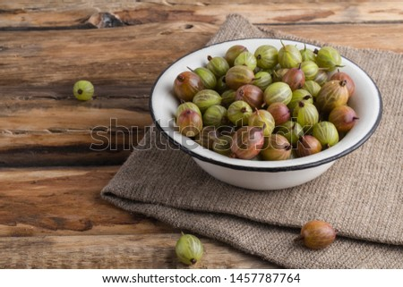gooseberry in an iron plate on wood background rustic Desk rustic style