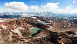 Gorely Volcano crater lake and impressive glacier with Mutnovsky Volcano in the background, Kamchatka, Russia