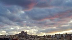 Goreme, Cappadocia, Turkey on sunset. Famous center of balloon fligths. Rose sunset over beautiful rocks of Cappadocia