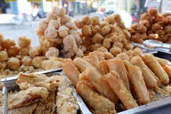 Gorengan is a typical snack from Indonesia. Usually consists of tempeh, tofu, cassava, and bananas. This food is usually sold by street vendors at cheap prices.