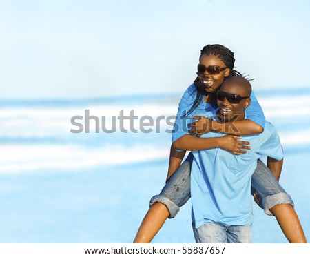 Gorgeous African American couple have fun at the seaside