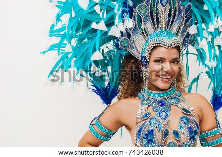 Gorgeous and cheerful samba dancer portrait wearing blue traditional costume