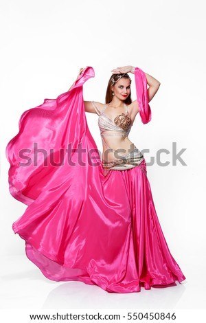 c327bf74176d Gorgeous Arabian bellydancer sexy woman in bellydance pink costume on white  background. Sensual arabic girl · Beauty girl dance in traditional ...