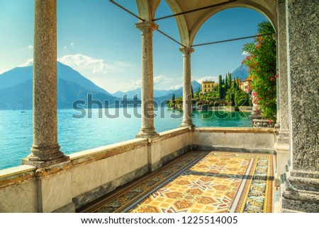 Gorgeous balcony of a fabulous mediterranean luxury villa with decorated floor and breathtaking view from the villa Monastero, lake Como, Varenna, Italy, Europe