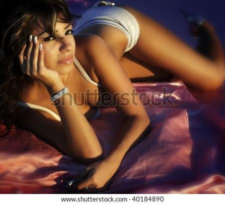 Gorgeous beautiful latino young woman in glamor photo shoot