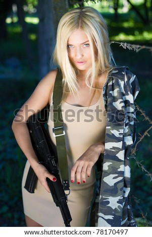 Gorgeous blond is fond of military style