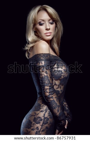stock photo gorgeous blonde in lace dress isolated on black studio shot