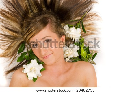 Gorgeous brunette face shot with gardenia flowers