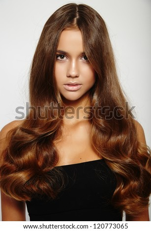 Gorgeous brunette young woman with long glamorous hair