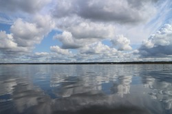 gorgeous cloudy landscape cumulus clouds are reflected in the water surface of the lake a soothing relaxing landscape