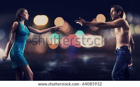 stock photo : Gorgeous couple over night city street background