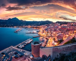 Gorgeous evening cityscape of Calvi port. Fabulous summer sunset on Corsica island, France, Europe. Incredible seascape of Mediterranean sea. Traveling concept background.