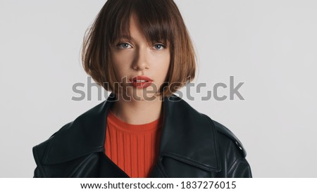 Gorgeous fashion model with bob hair and red lips looking disheveled on camera isolated on white background Stockfoto ©