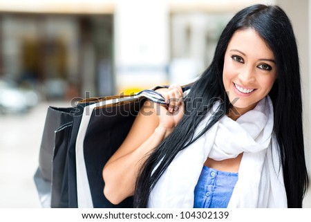 Gorgeous female shopper at the shopping center