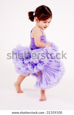 gorgeous girl dancing wearing a frilly lavender skirt