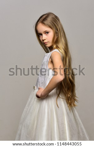 gorgeous girl. gorgeous girl in white dress. gorgeous girl with long blonde hair. gorgeous girl on grey background. pure joy. #1148443055