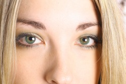 gorgeous girl with green eyes upclose