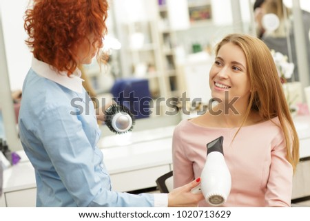 Gorgeous happy young woman smiling talking to her haordresser at the beauty salon communication people lifestyle leisure service professionalism positivity fashion pampering femininity. #1020713629